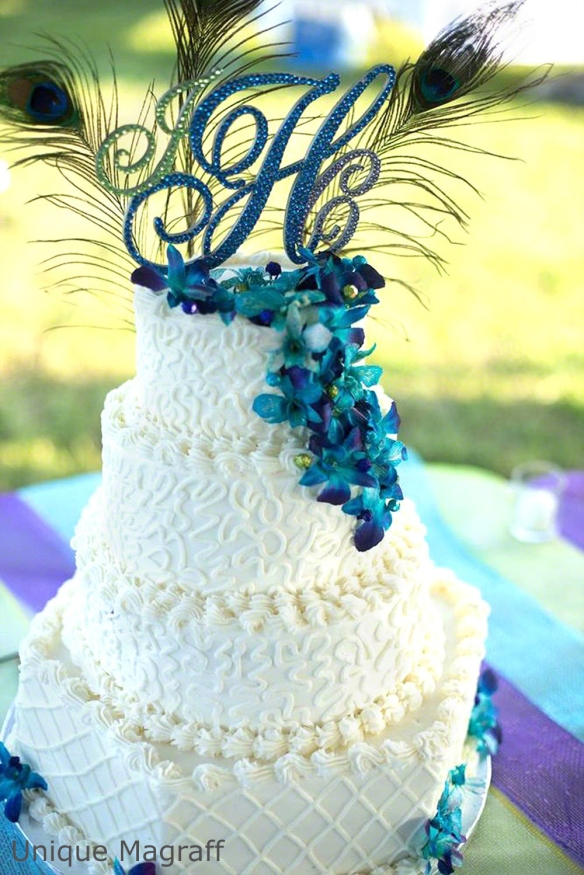 Unique Magraff blue mono cake topper